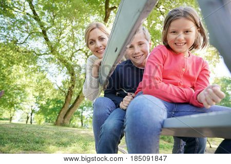 Mother with kids having fun outside