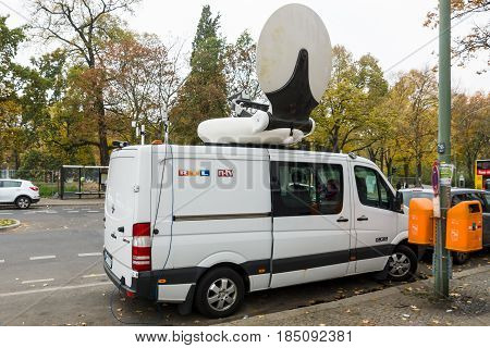 BERLIN - OCTOBER 30 2015: Centre for the reception and registration of refugees - LaGeSo. Mobile TV car of the German news broadcaster NTV.