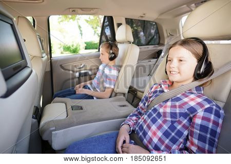 Kids riding car and watching movies