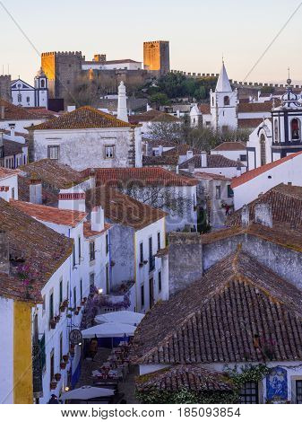 OBIDOS PORTUGAL - APRIL 03 2017: Cityscape of Obidos Portugal at sunset.