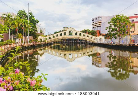 MALACCA, MALAYSIA - AUGUST 13, 2016: An arch bridge over the Malacca river near Jambatan Old Bus Station. Malacca City was listed as a UNESCO World Heritage Site on 7 July 2008