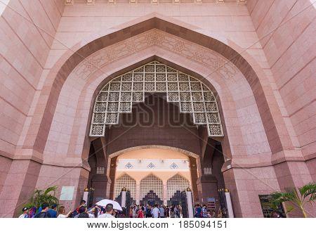 PUTRAJAYA, MALAYSIA - AUGUST 15, 2016: Entrance gate of Putra Mosque (Masjid Putra) the principal mosque of Putrajaya Malaysia.