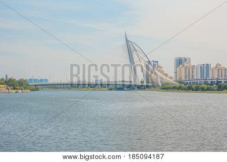 PUTRAJAYA, MALAYSIA - AUGUST 15, 2016: Seri Wawasan Bridge on August 15, 2016 in Putrajaya. It is a 370m long bridge which is built across the Putrajaya Lake in Putrajaya Malaysia.