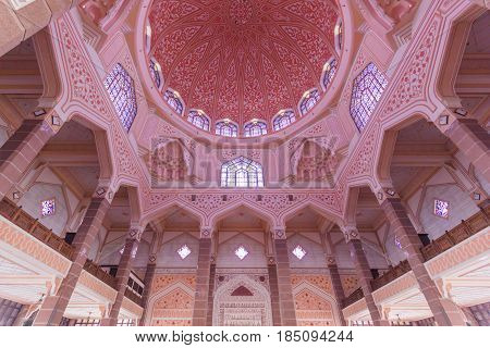 PUTRAJAYA, MALAYSIA - AUGUST 15, 2016: Inside of Putra Mosque It is constructed with rose-tinted granite and located in a popular touristic and administrative location.