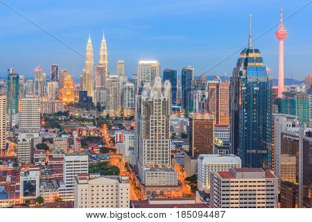 KUALA LUMPUR, MALAYSIA - AUGUST 14, 2016: Kuala Lumpur cityscape showing Petronas twin tower also known as KLCC building during blue hour from the top of Regalia Residence Kuala Lumpur Malaysia.