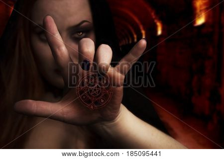 Woman with pentagram. Woman with magical pentagram on her palm standing in the castle photo.