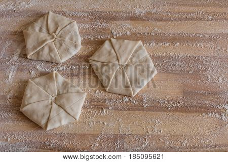 Homemade pastries with cheese on wooden board