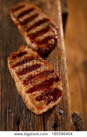 beef marbled steak with vintage old wooden background