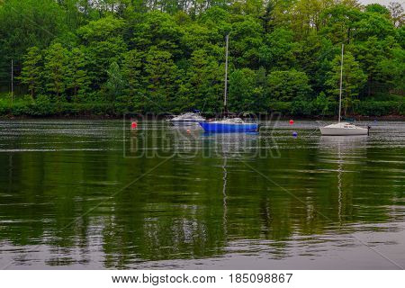 Sailboats moored along the shoreline of Nova Scotia, Canada.