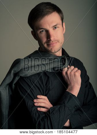 Portrait of a businesslike businessman with a jacket on his shoulder