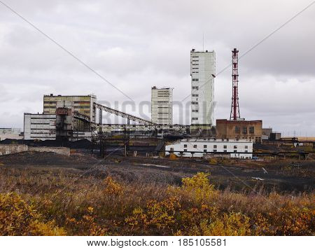 Autumn tundra view of coalmine building in northern russia town