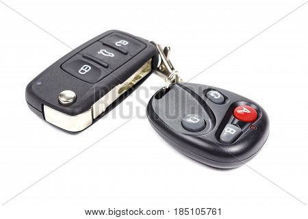 Garage door remote control with closed ignition key on a white background