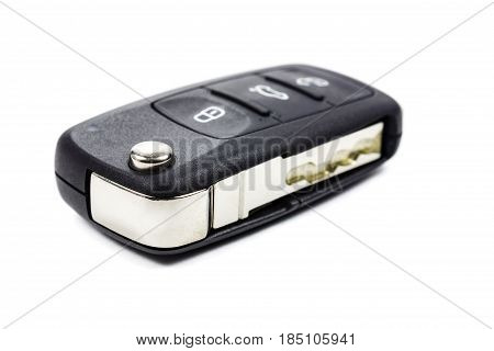 Closed ignition key on a white background