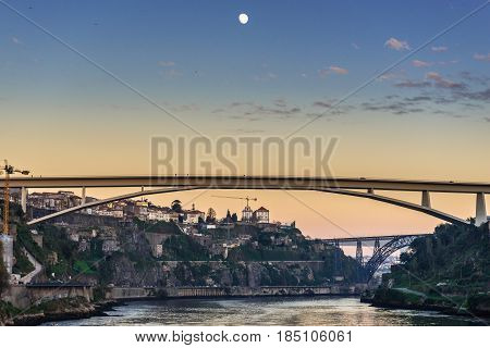 Prince Henry Bridge between cities of Porto and Vila Nova de Gaia Portugal. Old and new railway bridges on background