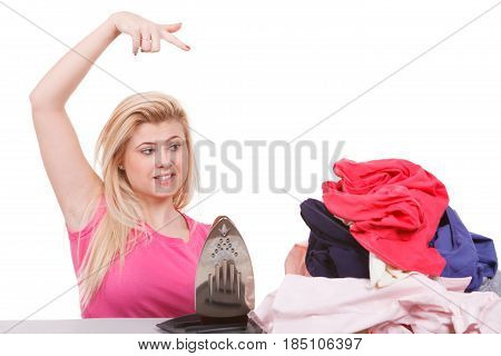Bored Woman Pointing At Clothes To Iron