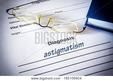 Diagnosis list with Astigmatism and glasses. Eye disorder concept.