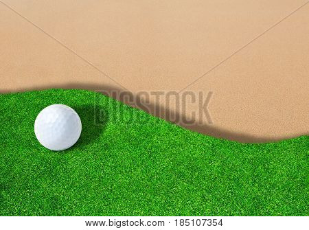 3D rendering of golf ball on edge of sand trap bunker with copy space.