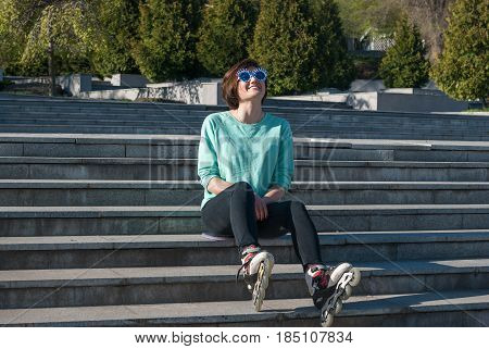 Sporty Young Woman Its On The Steps In The Park And Expressively Laughing
