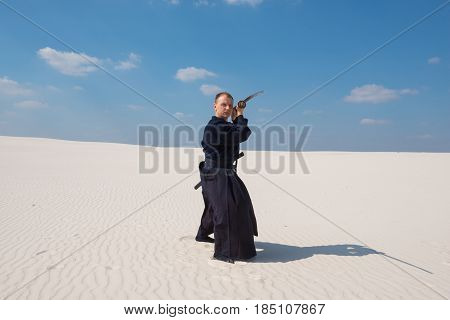 Man With Sword In Traditional Japanese Clothes Took The Position