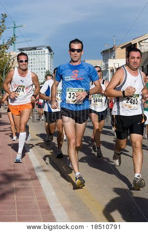 VALENCIA, SPAIN - NOVEMBER 15 : Runners compete in the 10K IX Vuelta a Pie Valencia run on November, 2010 in Valencia, Spain.