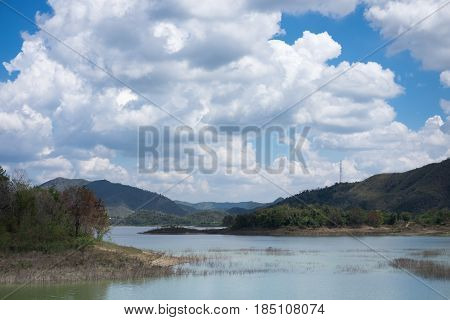 Sky, Cloud And Ground Front Of Lake Kaeng Krachan Tourist Area In Thailand. This Image For Landscape