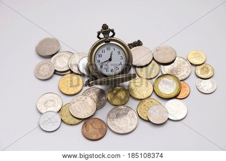 Silver Pocket Watch Putting On Various Sizes Coin Stack With White Background,this Image For Money S