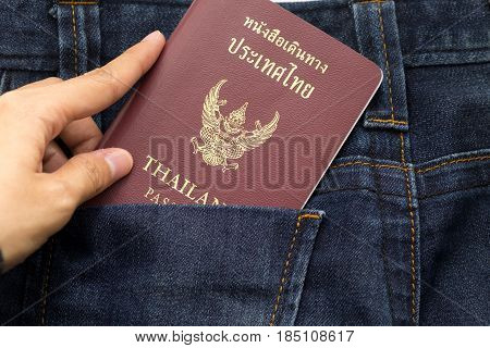 Hand Holding Thailand Passport Insert Back Pocket Blue Jean Pants, This Image For Fashion And Travel
