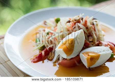 Top View. Papaya Salad Seems Spicy But Also Delicious And Have Salted Egg Put On Top. This Image For