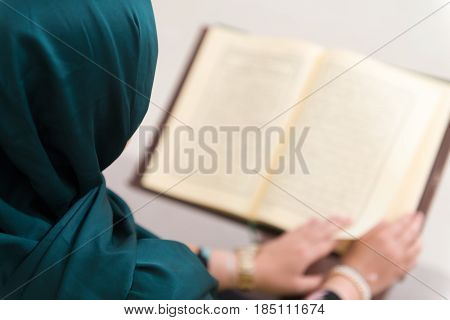 Close-up Muslim Woman Is Reading The Koran