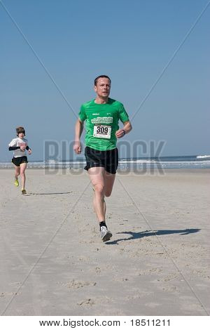 JACKSONVILLE BEACH, FLORIDA - FEBRUARY 14: Runner Fredrik Granstrom, age 42 of Jacksonville,  finishes in 4th place in the 5 mile Winter Beach Run on February 14, 2010 in Jacksonville Beach, Florida.