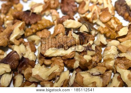 Large number of walnut kernels on a white table