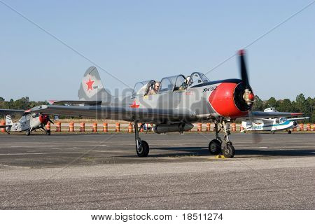 PALM COAST, FLORIDA - MARCH 27: A Soviet Union Yak 52 trainer aircraft prepares for takeoff at the Wings Over Flagler Air Show at the Flagler County Airport on March 27, 2010 in Palm Coast, Florida.