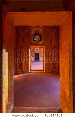 Lined Doors And Passages In Orange Toned Corridor With Decorated Walls. Interior Of The Majestic Amb