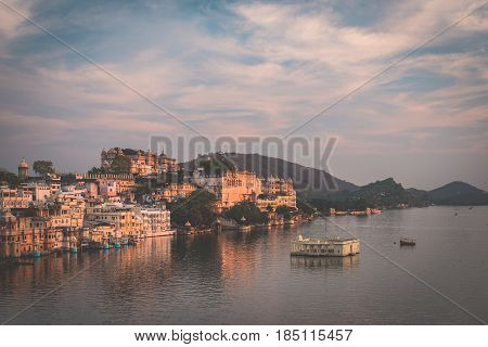 Udaipur Cityscape With Colorful Sky At Sunset. The Majestic City Palace On Lake Pichola, Travel Dest