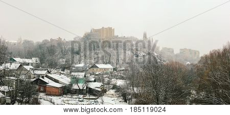 socialist soviet buildings at winter town with gothic tower