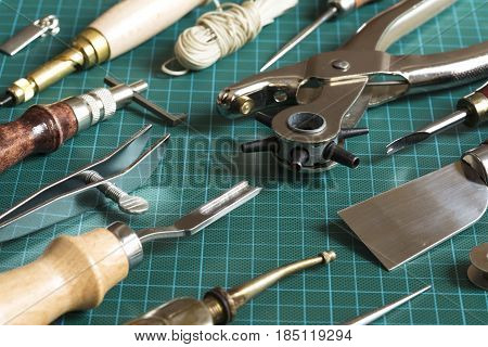 Leather craft tools on a cutting mat