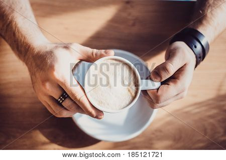 Top View Of Man Hand Holding A Cup Of Coffee , A Cup Of Coffee And A Man's Hand