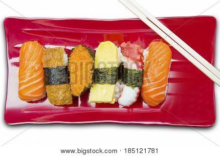 Closeup of variety sushi nigiri with chopsticks isolated on white background