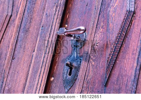 A church door whose locking structure reminds the old times