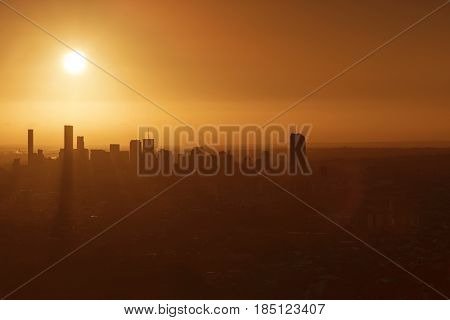 Sunrise over Brisbane, giving a silhouette of the cityscape. Viewed from Mt Coot-tha lookout