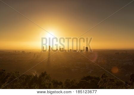 Sunrise over Brisbane and surrounds, giving a silhouette of the cityscape. Viewed from Mt Coot-tha lookout