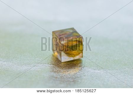crystal made of epoxy resin close-up with bokeh on background shallow depth of field poster