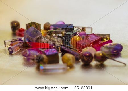Flowers and glitters inside of crystals made of epoxy resin close-up with bokeh on toned background shallow depth of field poster