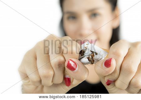 Woman destroying cigarettes in her hand concept of quit smoking isolated on white background