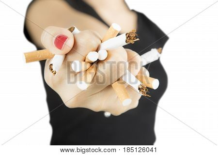 Woman destroying cigarettes in her hand concept of refuse bad habit isolated on white background