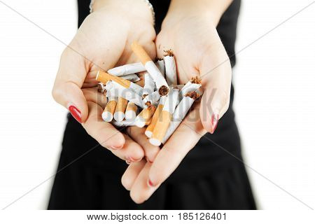Woman showing broken cigarettes in her hand concept of quit smoking isolated on white background