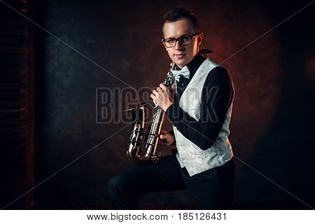 Male saxophonist playing classical jazz on sax