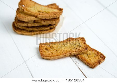 Crostini without toppings on a white background. A crostino is a small slice of toasted or grilled bread used in Italian cuisine for appetizers. It's an healthy food a versatile snack to eat just plain with vegetables cheeses or meats!