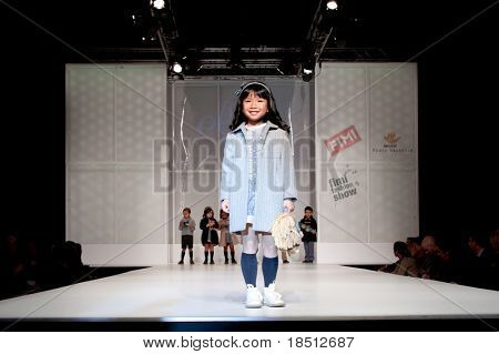 VALENCIA, SPAIN - JANUARY 21: An unidentified child model at the FIMI Children's Winter Fashion Show with the designer Elisa Menuts in the Feria Valencia on January 21, 2011 in Valencia, Spain.