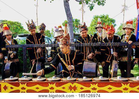 Penampang,Sabah-May 31,2016:Young man from Kadazandusun ethnic playing traditional musical instrument called the